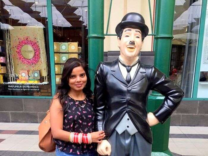 Jyoti with Charlie Chaplin statue in Mauritius