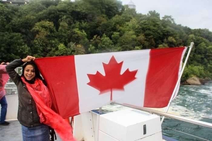 Leena waving the flag of Canada