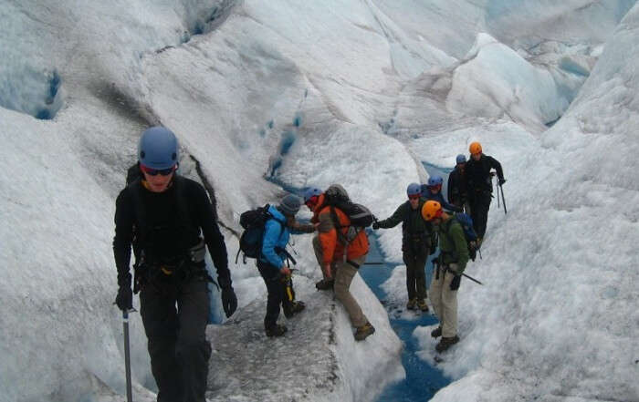 Hikers going through a tiring and difficult trek to the ice caves