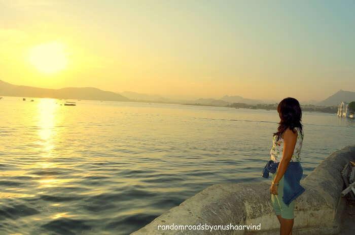 Anusha witnessing the sun rise in Lake Pichola Udaipur