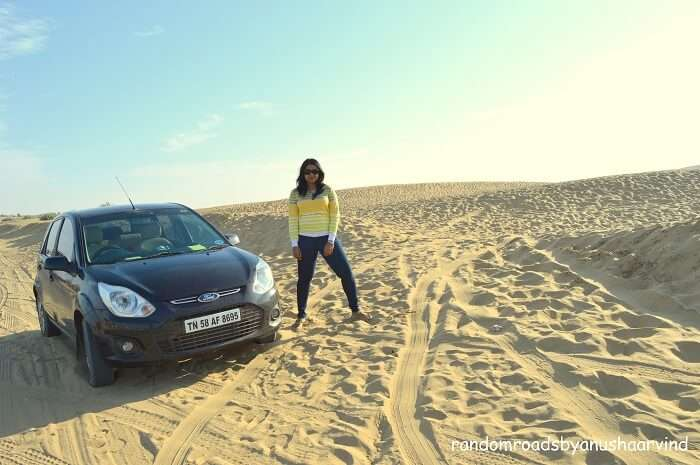Anusha in the Jaisalmer Desert with her Ford Figo