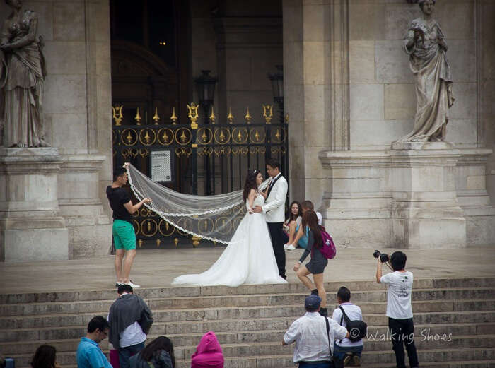 A married couple outside a church in Paris