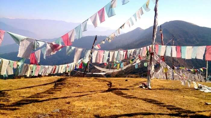Colourful flags flying across a Bhutan hilltop