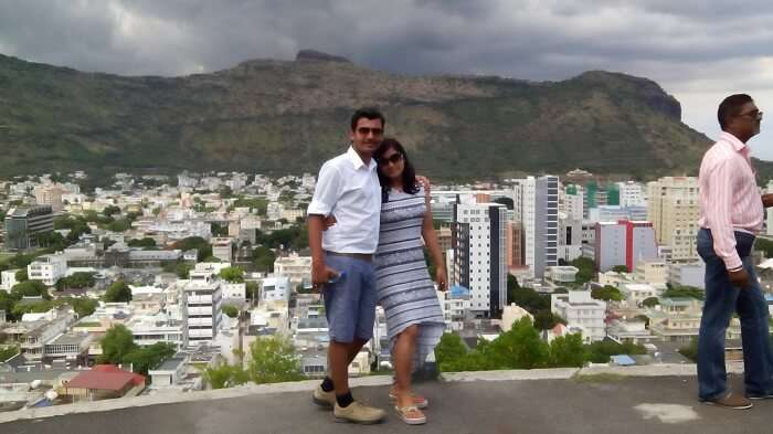 Manuj and his wife pose in the beautiful background of Port Louis