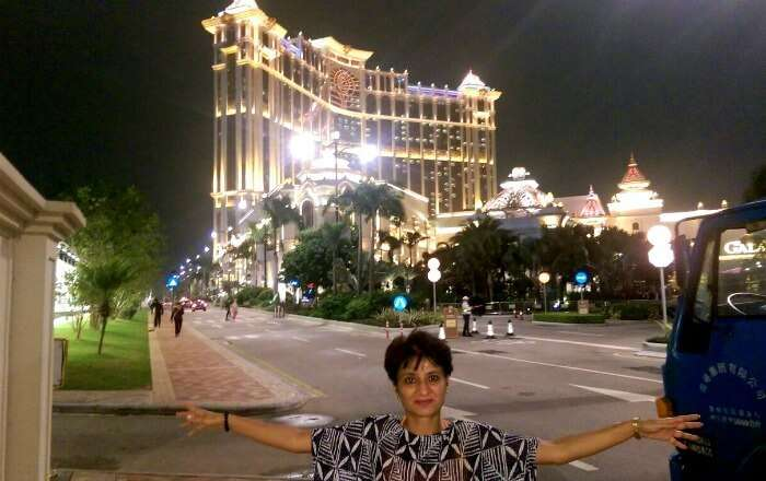 Posing in front of the gorgeously lit up Macau