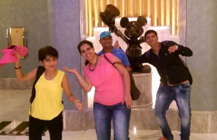 Posing with a Mickey Mouse Statue