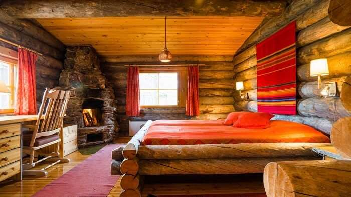The comfortable interiors of log cabins at Kakslauttanen Igloo Hotel in Finland