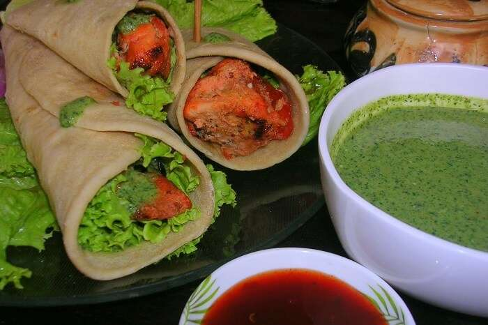 Chicken wraps served with sweet and spicy chutneys