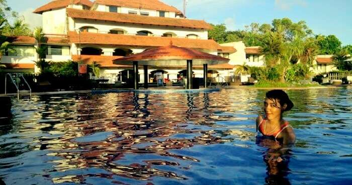 Candida swimming in a resort in Kerala