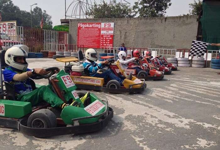 Racers get ready before F-9 Go-kart racing in Gurgaon