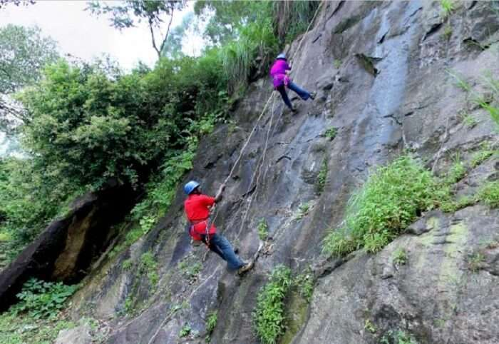 People try rock-climbing in Munnar