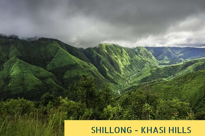 Storm clouds gather over the Khasi Hills as dawn breaks over the deep valley gorges near Shillong