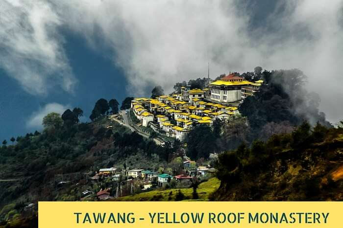 Clouds pass over the yellow roofed monastery at Tawang on an early summer morning