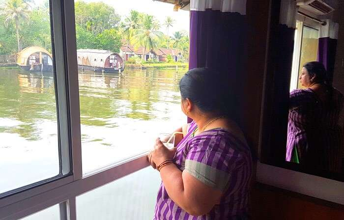 Mohan's wife admiring the view from the houseboat