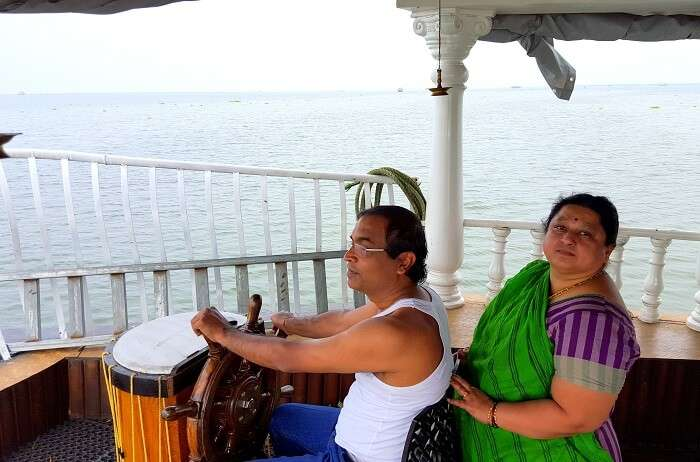 Mohan driving the houseboat