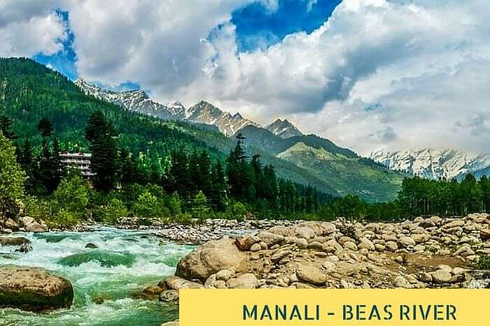 The flowing river Beas at Manali with thee quaint hills in the background
