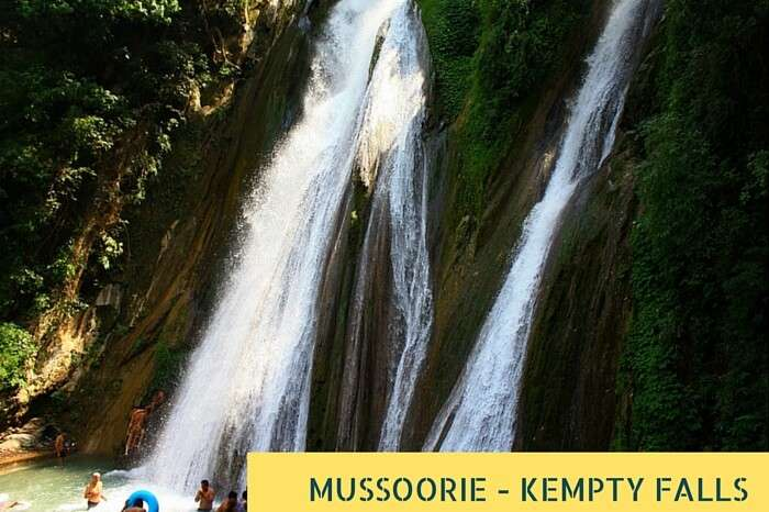 Tourists taking bath at the famous Kempty Waterfalls near Mussoorie during summer holidays in India
