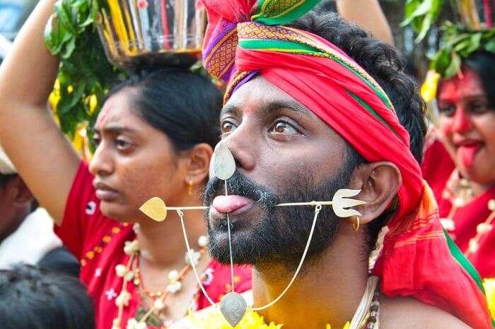 A Kavadi with pierced tongue and cheeks at Batu Caves Temples