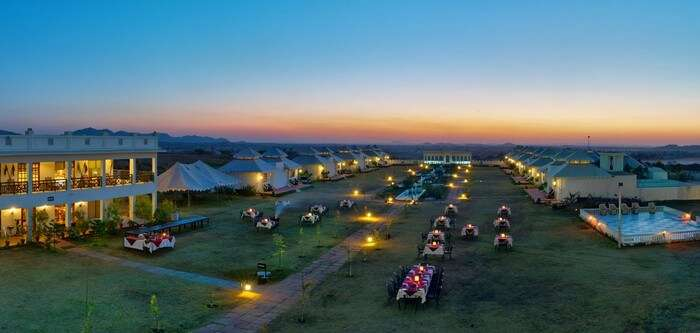 Staying in the luxurious tents of Aarambagh and outdoor dining is one of the best things to do in Pushkar