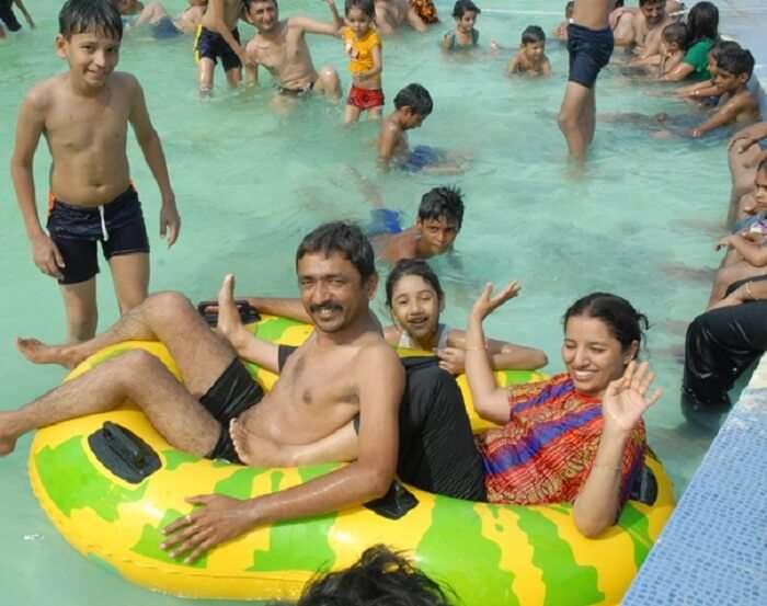 A family enjoys happy time at the Ajwa Fun World