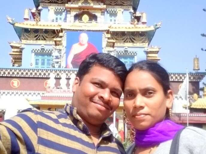 Naveen and his wife click a selfie outside a Tibetan Monastery