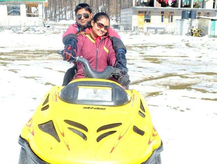 Madhumita and her husband drive the snowmobile