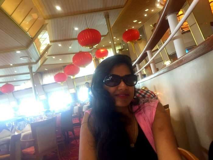 Kavya in the restaurant of the Star cruise