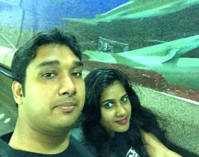 Ram and Kavya at the giant aquarium in Sentosa