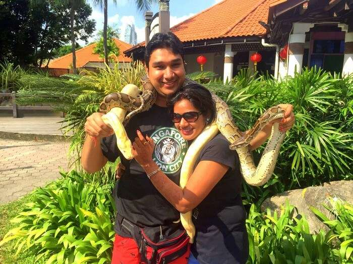 Ram and Kavya with a giant snake in Sentosa Island