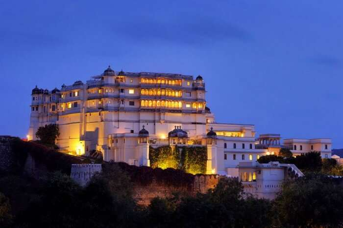 Brightly-lit Raas Devigarh hotel from outside