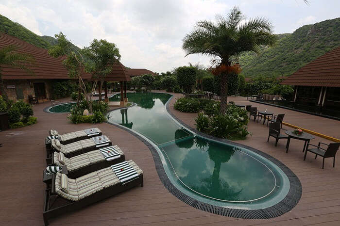 The swimming pool at Ananta Resort that offers a clear view of the Aravalli mountain range