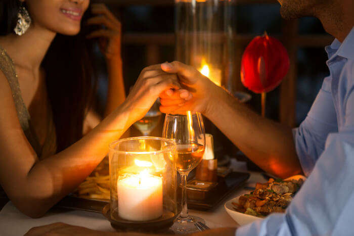 A couple enjoying a romantic meal at a restaurant in Bangalore