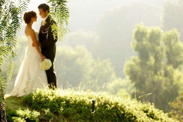 Honeymooner enjoying views of Munnar, a romantic tea town in South India