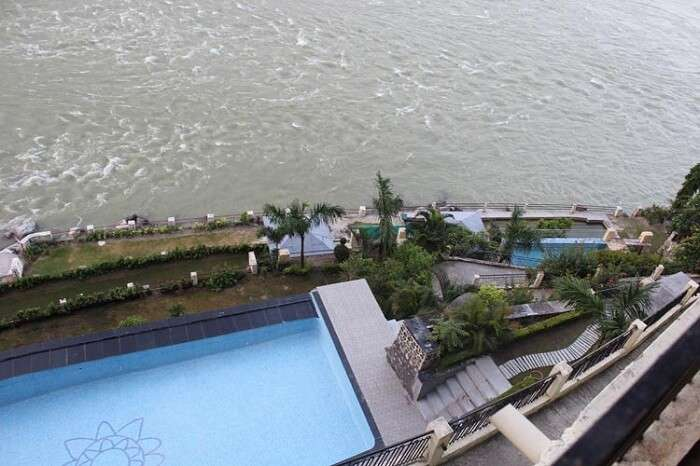 An aerial shot of the swimming pool at the Divine Resort In Rishikesh
