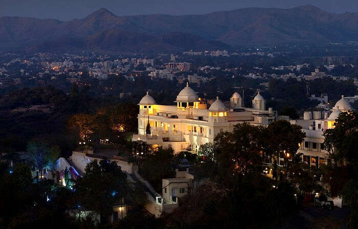 A night shot of the exterior of the Lalit Laxmi Vilas Palace