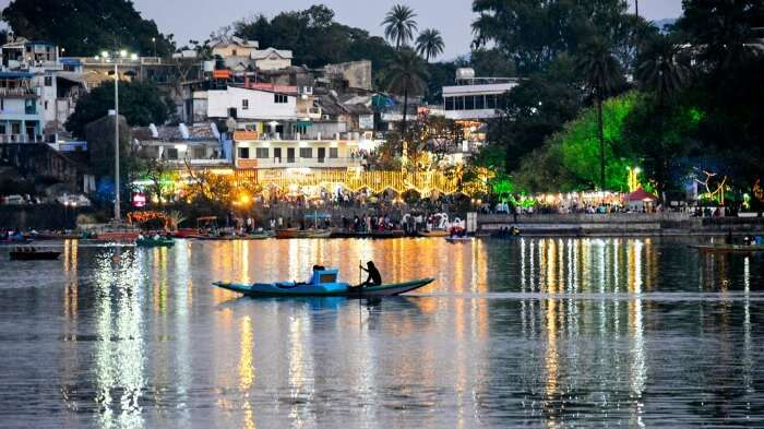 A man rowing a boat in Nakki Lake in Mount Abu