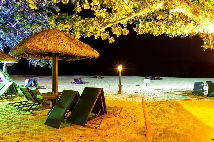 The seating arrangement at the well-lit Pantai Tengah beach at night