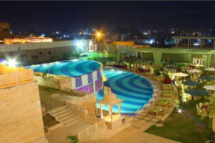 2-level swimming pool and the surrounding lawn at the Radisson Blu Resort