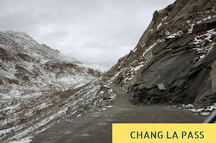 The slippery road amidst the snowclad mountains near Chang La Pass