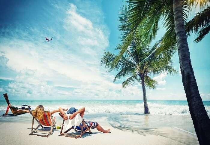 Couple lounging seaside during their honeymoon in Lakshadweep
