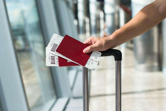 Passenger holding his boarding pass