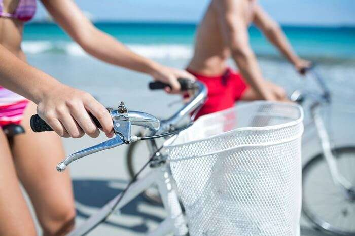 Couple riding bikes to get to and fro on islands in Lakshadweep