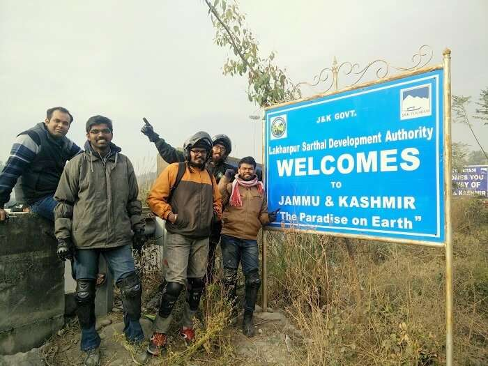 Sundar and his friends pose with Welcome to Kashmir board