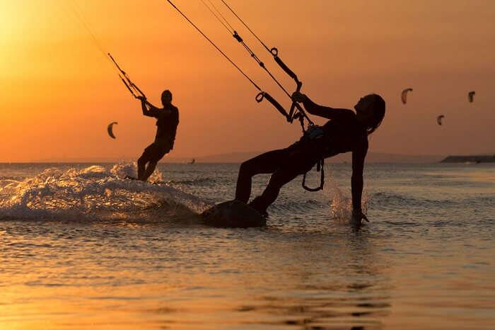 Couple enjoying kitesurfing on their Lakshadweep honeymoon