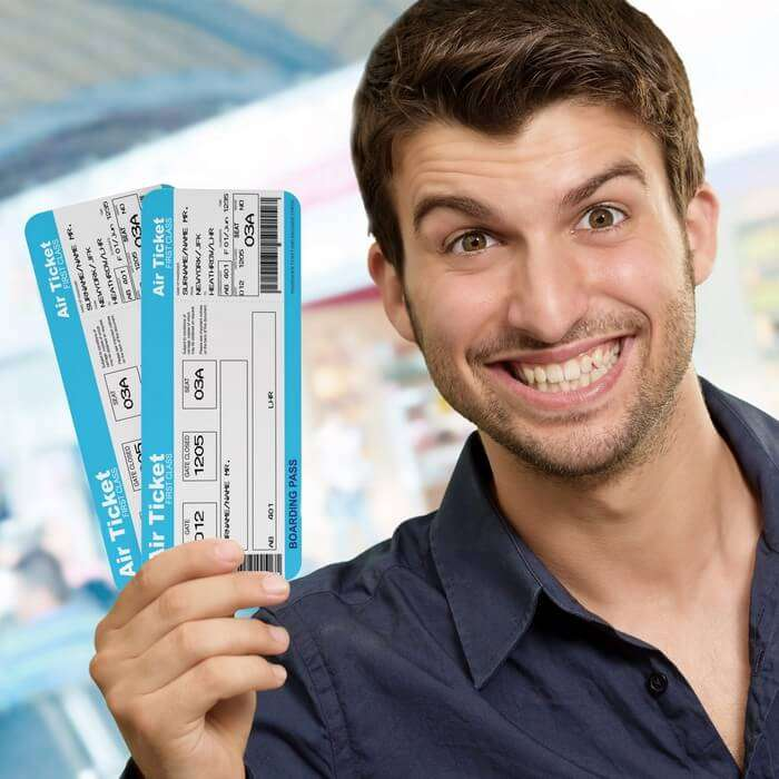 A person with boarding pass posing for social media