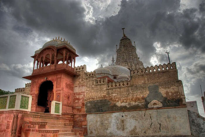 The cloud-covered sky over the grand Shri Laxminath Temple that is one of the religious places to visit in Bikaner