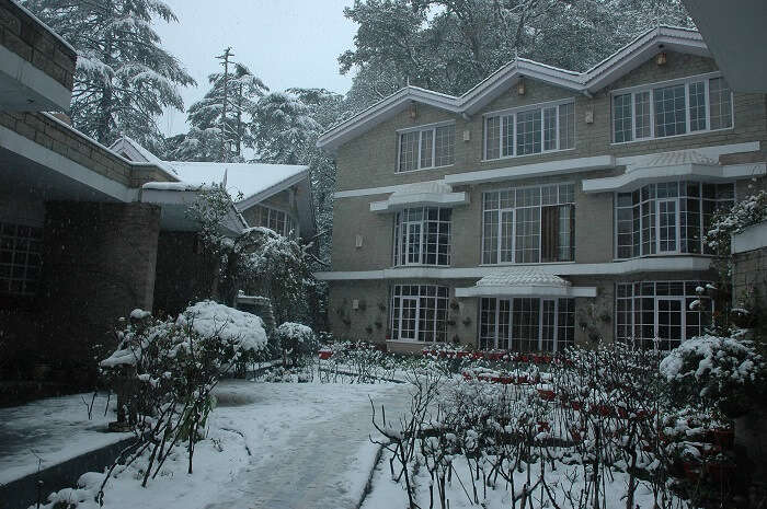 Victorian facade of East Bourne Resort covered in snow in Shimla