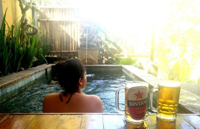 Ritika in the private pool of their room in Bali