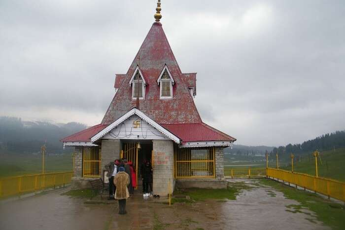 Tourists take blessings at the Maharani Temple in Gulmarg