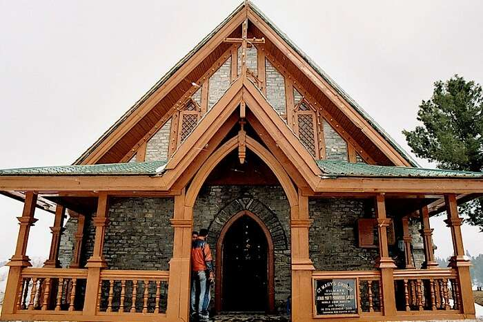 Tourists visit the colonial-style St Mary Church in Gulmarg